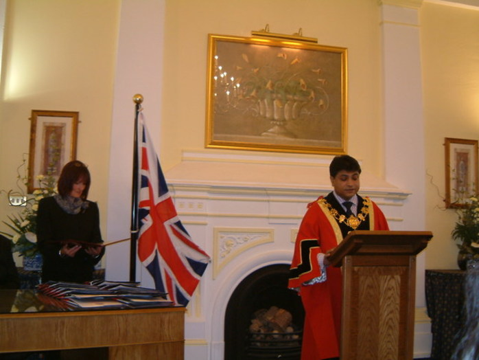 British citizenship ceremony flag Union Jack robes