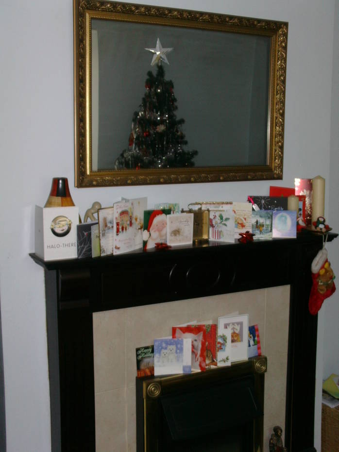 Christmas cards mantelpiece fire decorations holidays celebrate