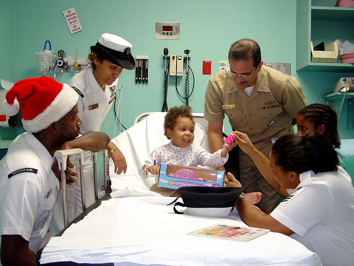 Christmas hospital work nurse navy sick child present