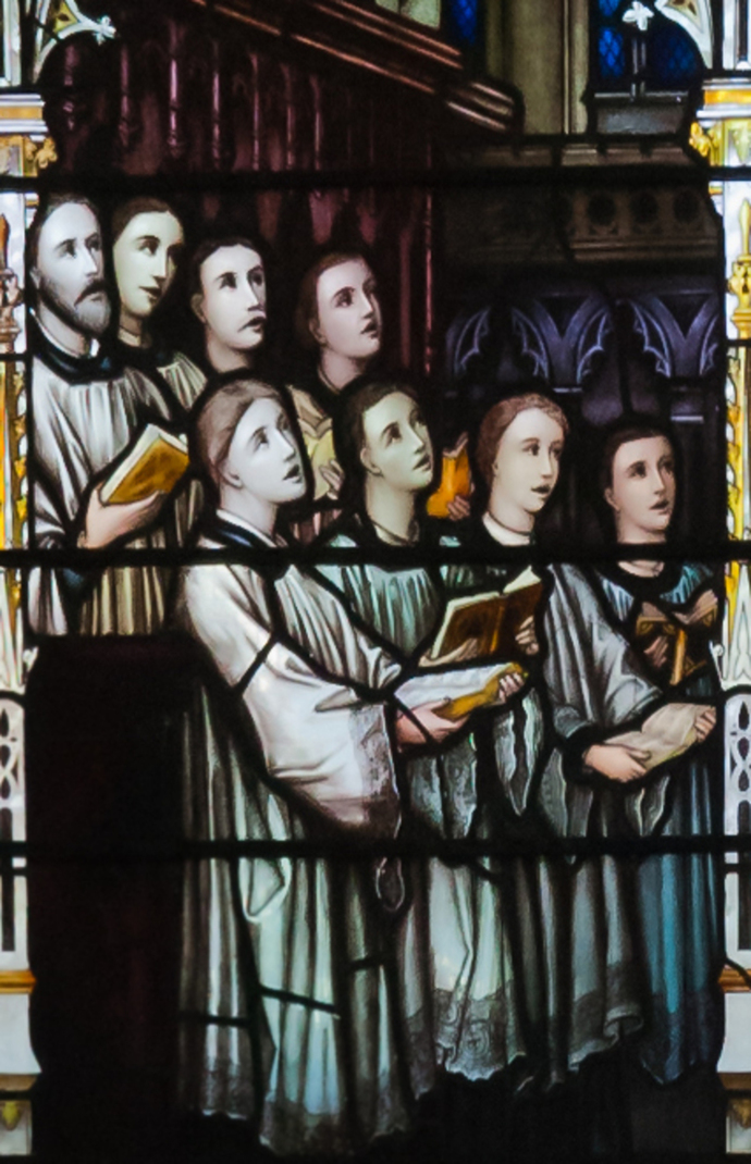 church choir singing carols Christmas stained glass window