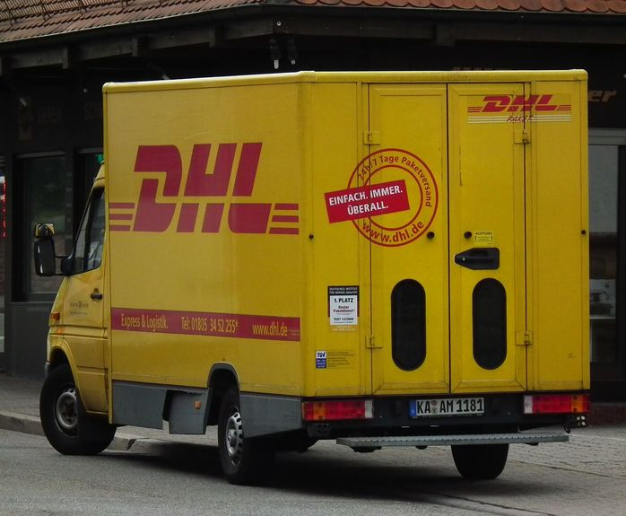 DHL parcel present delivery courier van truck lorry post