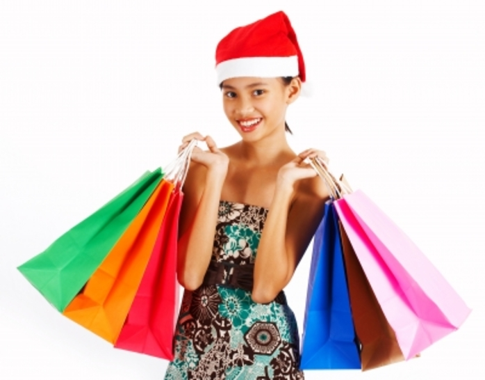 girl presents shopping Christmas Santa hat