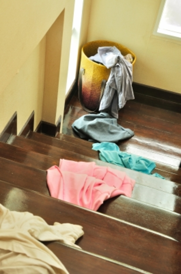 mess clothes laundry basket stairs house untidy