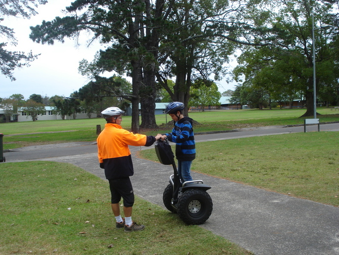 personal transporter, Segway, riding a bike