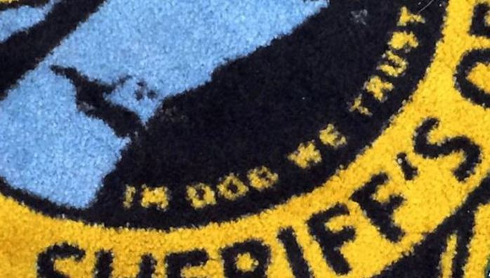 US Sheriff rug in dog we trust mistake error