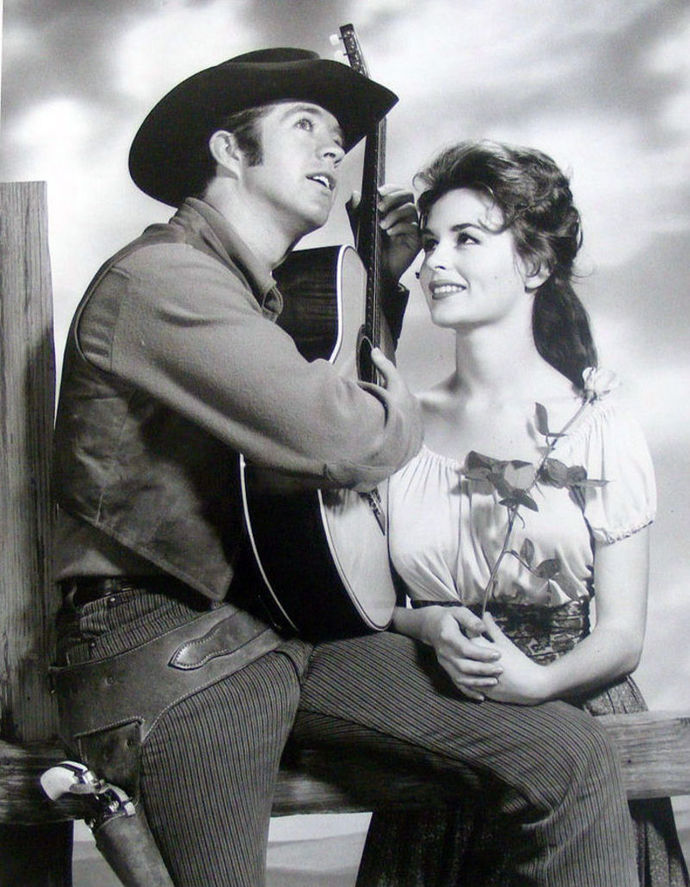 Clu Gulager as Billy the Kid and Marianna Hill