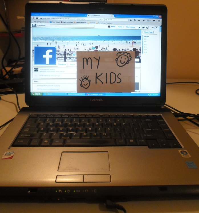 Laptop with Facebook symbol