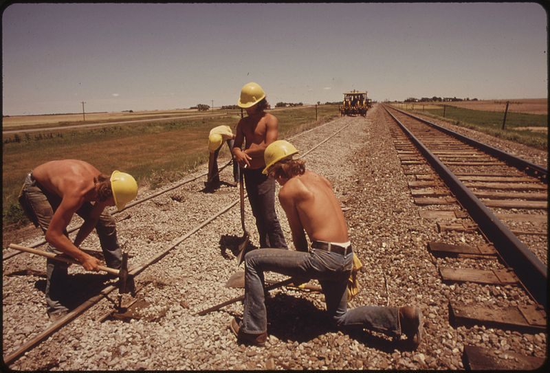 railway workers, kansas  - Why aren't fathers who work referred to as 'working fathers'?